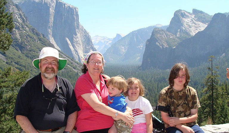 Family Standing In Front Of Canyon