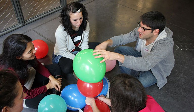 Students With Balloons In A Classroom