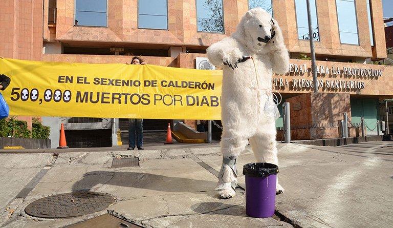 Coca Cola Polar Bear Pouring Soda Into Trashcan