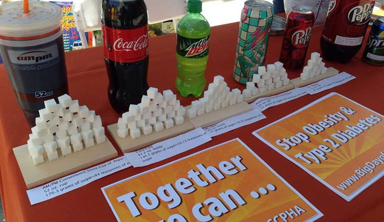Sugar Cubes On Display In Front Of The Beverage They Represent