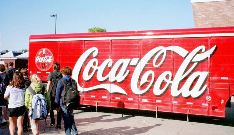 Students Walking By A Coca-Cola Truck