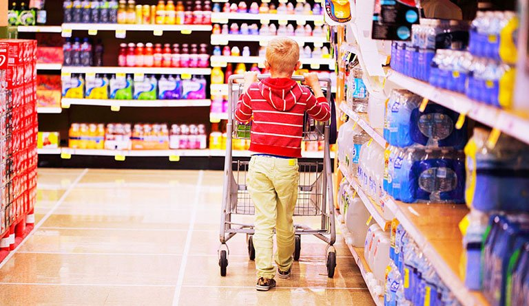 Kid Pushing Shopping Cart In Supermarket