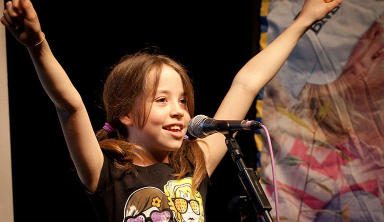 Girl Standing At The Microphone