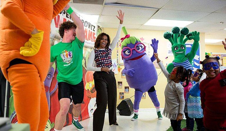 "Michelle Obama dancing with ""Let's Move"" Mascots In A Classroom"