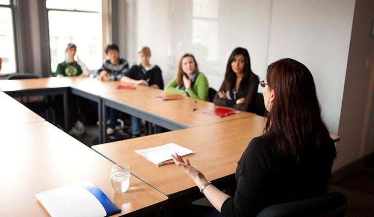 Students And Mentors In A Conference Room