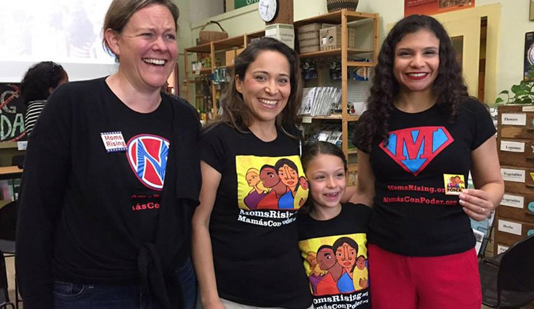 Women And Girls Wearing Mom's Rising Good Food Force T-shirts