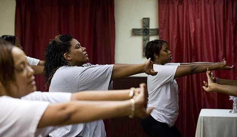 Women Stretching In Church