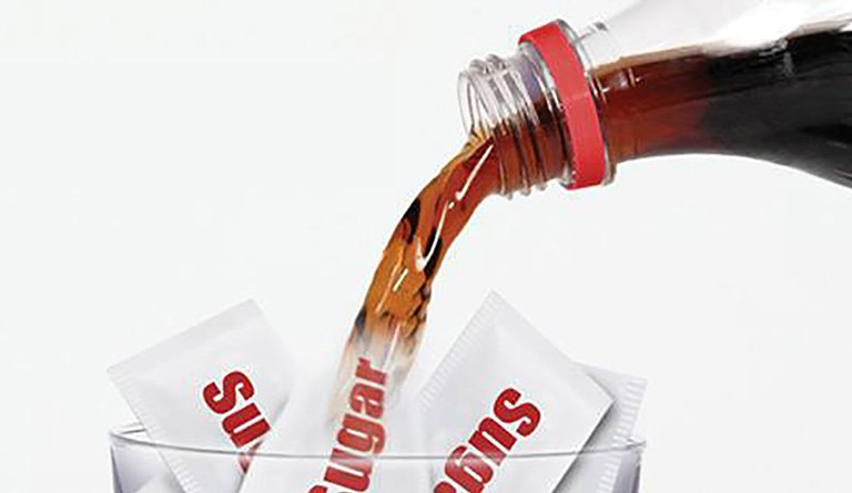 Soda Being Poured Into A Coup With Sugar Packets