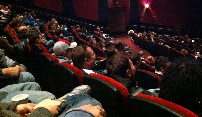 Patrons Watching A Film In A Movie Theater